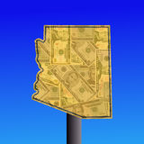 Arizona sign with cash. Warning sign in shape of Arizona with American dollars Royalty Free Stock Images