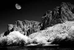Arizona Sonora Desert Moon at Salt River in infrared monochrome. Infrared monochrome desert moon over the southwestern USA Sonora desert and Salt River Arizona stock photos