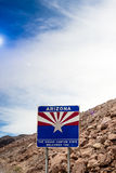 Arizona State Border Highway Sign Against Sky Blue Background. L Royalty Free Stock Image