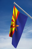 Arizona State Flag. With clipping path, against a blue sky with clouds royalty free stock images