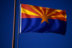 Arizona State Flag flying from flagpole Royalty Free Stock Photos