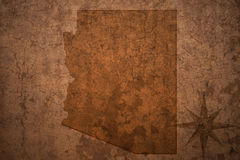 Arizona state map on a old vintage paper background. Arizona state map on a old vintage crack paper background royalty free stock photos