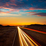 Arizona sunset at Freeway 40 with cars light traces Stock Image
