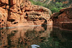 Arizona swimming hole. Red rock swimming hole in Arizona with sandstone cliffs stock image