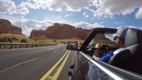 ARIZONA, USA - MAY 13, 2019: Man driving convertible car