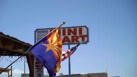 ARIZONA, USA - MAY 13, 2019: Mini mart shop sign. At freeway in desert stock video footage
