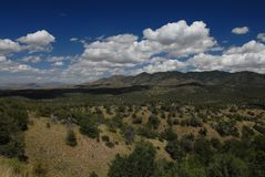 Arizona Views. A landscape showing the foothills, scrubland and sky with white puffy clouds Royalty Free Stock Photo