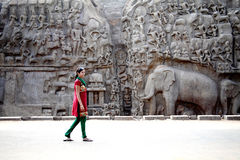 Arjuna's Penance - Descent of the Ganges, Mahabalipuram, India. Youn woman walking at Arjuna's Penance - Descent of the Ganges, Mahabalipuram, India Stock Images