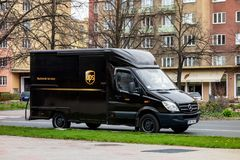 Ark brown Mercedes-Benz Sprinter van on a street delivering a package. OSTRAVA, CZECH REPUBLIC - APRIL 5, 2019: Dark brown Mercedes-Benz Sprinter van on a street royalty free stock image