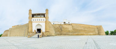 The Ark Fortress. Panorama of the Ark large earthen fortification with the gate, serving as the museum entrance, Bukhara, Uzbekistan Stock Images