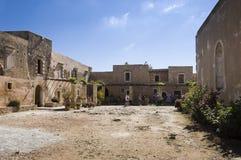 Arkadi monastery courtyard. Tourists on the courtyard of the Greek Orthodox Arkadi monastery, founded on 14th century AD,  Crete,  Greece Royalty Free Stock Photography
