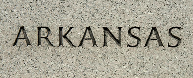 Arkansas Carved into Granite Stock Photo