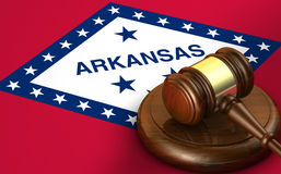 Arkansas Law Legal System Concept. Arkansas US state law, code, legal system and justice concept with a 3d render of a gavel on the Arkansan flag on background Stock Photos