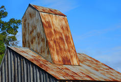 Arkansas` Ozark Diamond Mine Roof. Rustic roof, of the Ozark Diamond Mine`s historic shaft house, is framed by blue sky at the Crater of Diamonds State Park in Stock Image