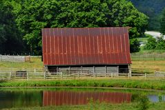 Ozark Barn and Pond in Northern Arkansas royalty free stock image