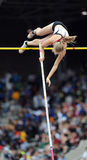 Arkansas pole vaulter clears the bar Royalty Free Stock Photo
