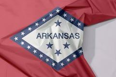 Arkansas tkaniny flaga zagniecenie z biel przestrzenią i krepa zdjęcia stock