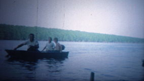 ARKANSAS, USA - 1964: Boat trip with kids showing off the latest fishing catch.