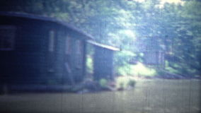 ARKANSAS, USA - 1965: Floating boathouses and living units on the flooded river. stock video
