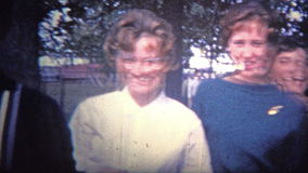 ARKANSAS, USA - 1965: Gang of nice teens showing the fashion trends of the time. Original vintage 8mm home movie film professionally cleaned and captured in 4k stock video
