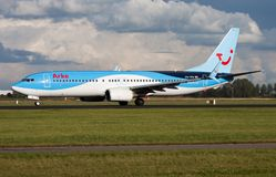 Arkefly TUI Boeing 737-800 PH-TFB passenger plane departure at Amsterdam Schipol Airport royalty free stock photos