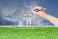 Arkitekthand som drar ett hus Arkivbild