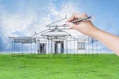 Arkitekthand som drar ett hus Arkivfoton