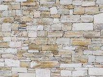 Arkitektonisk stenfasadbeklädnad som en bakgrundsbild Arkivfoton