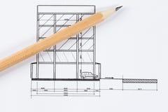 Arkitektoniskt projekt och pancil Arkivfoton