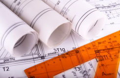 Arkitektur rullar arkitektoniska techical planarkitektritningar Arkivbild