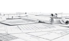 Arkitekturplan och rullar av ritningar Arkivfoto