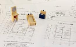 Arkitekturteckningar och plan av huset Arkivfoto