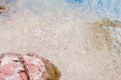Arkose pink stone , sand and seawater Royalty Free Stock Photography