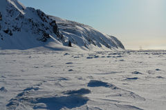 Arktic  Chukotka. Cliffs protruding from the snow. Stock Image