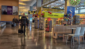 Arlanda Airport. Ravelling people waiting at Arlanda airport for their flight, they where a little early for their flight Stockholm, Uppland/Sweden stock images