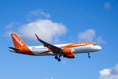 Easyjet, Airbus A320 - 214 flying royalty free stock image