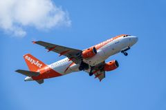 Easyjet, Airbus A319 - 111 take off in white clouds and blue sky royalty free stock images