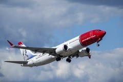 Norwegian Air Shuttle ASA, Boeing 737 MAX 8 take off. Arlanda, Stockholm, Sweden - July 10, 2018: Norwegian Air Shuttle ASA, Boeing 737 MAX 8 take off in white royalty free stock photos