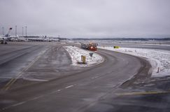 Snow and ice on airport tarmac. ARLANDA, SWEDEN - DECEMBER 31, 2018: Snow and ice on airport tarmac on an overcast day on December 31, 2018 at Arlanda airport royalty free stock images