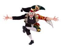 Arlekin jest ubranym maskę, odosobnioną na białym tle w pełnej długości Zdjęcia Stock