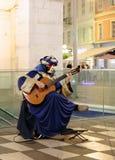 Arlekin z gitarą Zdjęcia Stock