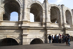 Arles Amphitheatre. Tourists visiting the Arles Amphitheatre, a Roman arena in the southern French Stock Images