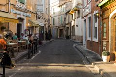 Cafe and restautants in the old town of Arles in Provence in the South of France. Arles, France - June 24, 2017: Cafe and restautants in the old town of Arles Stock Images
