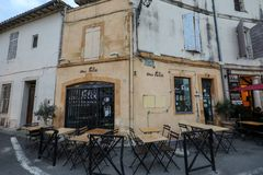 Cafe and restautants in the old town of Arles in Provence in the South of France. Arles, France - June 26, 2017: Cafe and restautants in the old town of Arles Stock Image