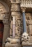 Romanesque sculptures and beasts on the west portal of The Church of St. Trophime stock photography