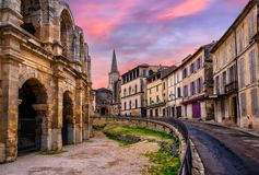 Arles Old Town and roman amphitheatre, Provence, France. In dramatic sunset light royalty free stock photography