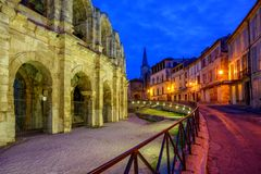 Arles Old Town and roman amphitheatre, Provence, France. At late evening light Stock Photos