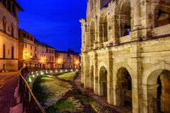Arles Old Town and roman amphitheatre, Provence, France. At late evening light Stock Photo