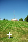 Arlington National Cemetery. A view from the Arlington National Cemetery with the Alington House (The Robert E Lee Memorial) on the top and a white cross by the Stock Image
