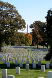 Arlington National Cemetery. Gravestones at Arlington National Cemetery with the Washington Monument in view Royalty Free Stock Image